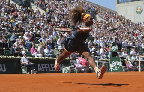 Associated Press/Michel Euler - Serena Williams, of the U.S, reaches for a ball as she plays Russia's Svetlana Kuznetsova during their quarterfinal match of the French Open tennis tournament at the Roland Garros stadium Tuesday, June 4, 2013 in Paris. (AP Photo/Michel Euler)